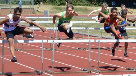 Hurdler Joe Purbrick (centre) during the Eastern Counties Championships at Peterborough. Picture: WA