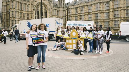 Katie Sutton and Amelia Bird from Sir John Lawes School outside parliament with the other Send My Fr