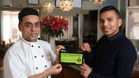 YUVA Fine Fusion Restaurant chef Altaf Hussain and manager Amran Hussain celebrate their very good f