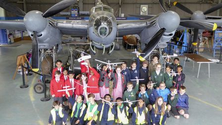 Some of the schools taking part in the glider competition, beneath a DH Mosquito B35. Picture: Garry