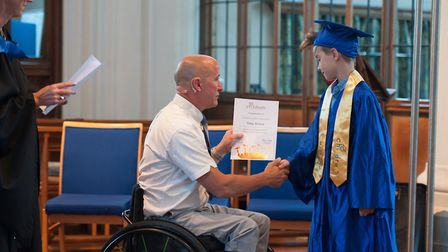 Sean Rose presenting a certificate to a graduate PICTURE: HONEYCOMB PHOTOGRAPHY