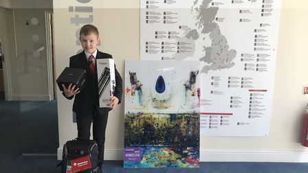 Max Fearey with his photograph and his prizes. Picture: Sandringham School