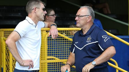 Northampton Town manager and former St Albans player Dean Austin talks with Manager of St Albans Ian