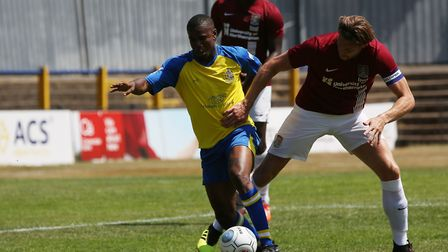 Khale Da Costa of St Albans holds off a tackle in the pre-season friendly match between St Albans Ci