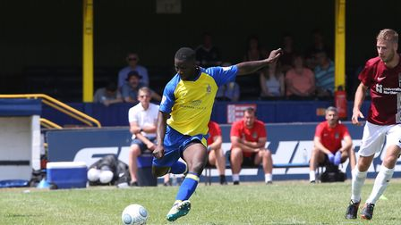 Percy Kiangebeni of St Albans plays a long pass in the pre-season friendly match between St Albans C