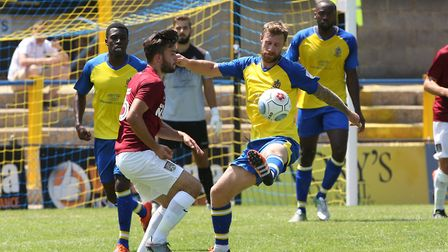 David Noble of St Albans clears the ball in the pre-season friendly match between St Albans City and