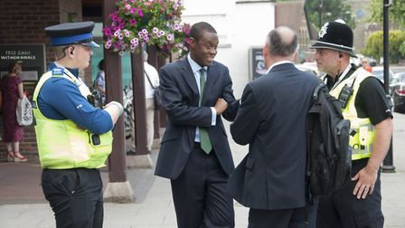 Hitchin and Harpenden MP Bim Afolami with PCSO Joshua Walton on the left and PC Art Wilkes on the ri