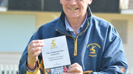 Godmanchester Town cricketer Kevin Clement with a copy of 'The Forgotten County' - his book charting