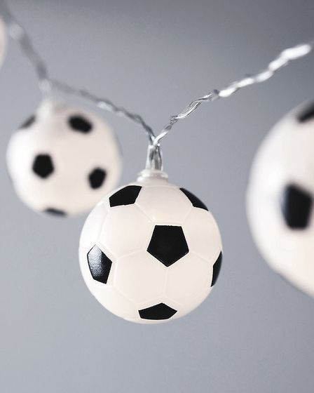 Floodlights: String of 10 with white LED housed within each 5cm football £7.99, www.lights4fun.co.uk