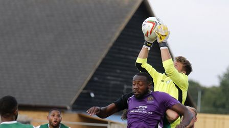 Biggleswade Town's Sam Donkin claims a cross above Tarik Moore-Azille of St Albans City. Picture: Le