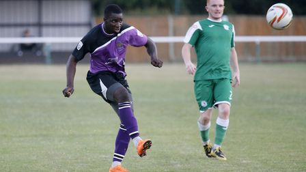 Percy Kiangebeni in action for St Albans City as Biggleswade Town's Jonny McNamara looks on. Picture