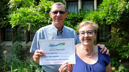 Trevor and Sue Jones with their in bloom certificate. Picture: CONTRIBUTED