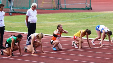 Roundwood Park School's Mia McIntosh gets set to win the junior girls 75m hurdles at the English Sch