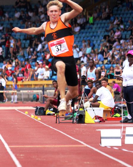 Roundwood Park School's Josh Woods took the victory in the intermediate boys' triple jump title at t