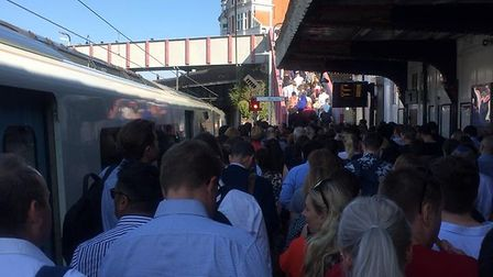 Passengers from the 7.52am from St Albans being removed from a train at Kentish Town due to trespass