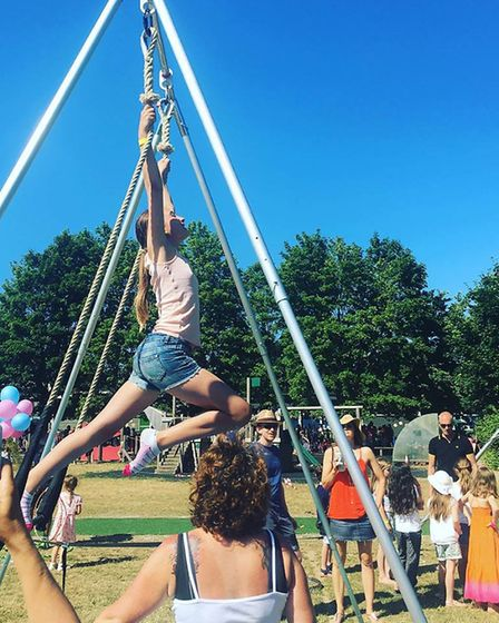 The static trapeze frames a The Grove Junior School's summer fete.