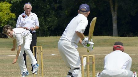 Godmanchester Town 2nds bowler Ethan Rice sends down a delivery during their Hunts League Division T