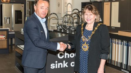 Manager Keith Sharp and mayor Cllr Sarah Gifford at the opening of the new Magnet shop in Huntingdon