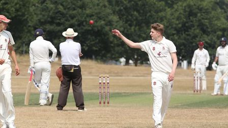 Harpenden's Will Downes prepares to bowl in the match between Harpenden and WGC. Picture: DANNY LOO