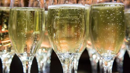 Glasses ready for a celebratory toast. Picture: Getty Images/iStockphoto / Lemanieh