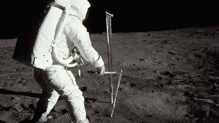 Buzz Aldrin takes soil samples on the surface of the Moon during the Apollo 11 mission. (Photo by ©