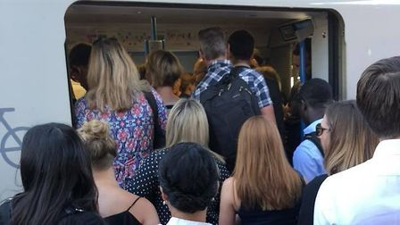 People attemtping to board an overcrowded Thameslink service. Picture: Daisy Cooper.