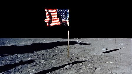 376713 22: (FILE PHOTO) The flag of the United States stands alone on the surface of the moon. The 3