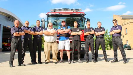 UK's Strongest Man competitor Phil Roberts (centre-right) and founder Glenn Ross (centre-left) with