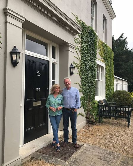 Mr and Mrs Walsh outside Dancers Hill House