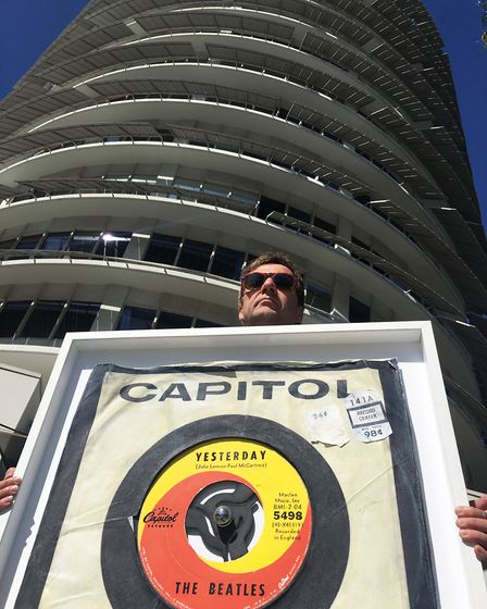 Morgan Howell with his hand-painted copy of the Yesterday single outside the Capitol Tower in Los An