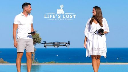 Ben Bryant and Amy O'Brien in a publicty shot for their business, Life's Lost Luggage