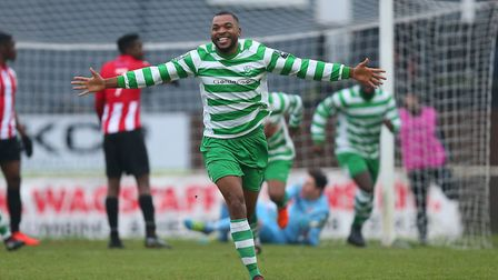 Christian Assombalonga of Waltham Abbey scores the first goal for his team and celebrates during AFC