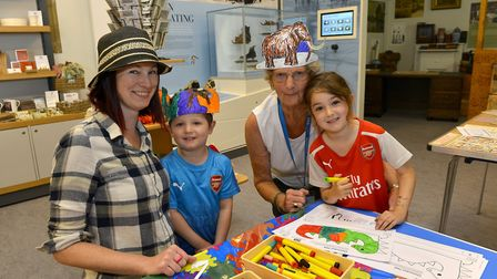 Making things are Nicola Newman with her kids, Rory and Aria with volunteer Valerie Chamberlaint. Pi