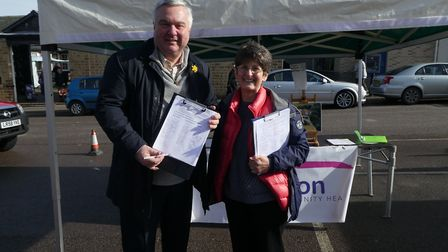 North East Herts MP Sir Oliver Heald joined Maggie Allen to petition in Royston last year. Picture