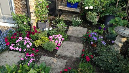 Sue Keenan's garden was awarded second place by Royston mayor Iain Leggett. Picture: Royston Town Co