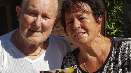 Bob and Rose Morgan with their card from The Queen. Picture: Valerie Clarke-Eccles