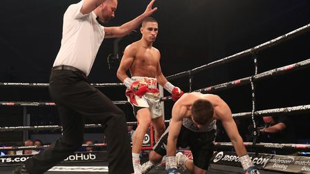 The referee steps in to stop the fight as Jordan Gill floors David Berna in Cardiff last Saturday. P