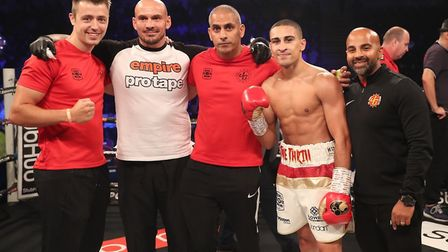 Jordan Gill celebrates his victory over David Berna with Danny Wilson (strength and conditioning coa