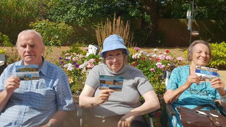 Residents of Orchard Nursing Home with postcards. Picture: Orchard Nursing Home