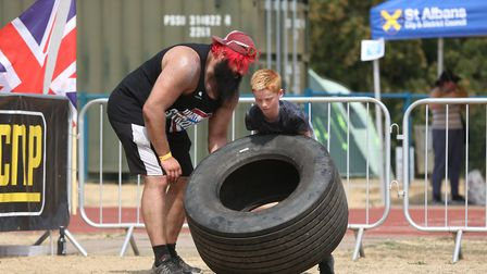 Finley Hayes, 10, has a go at a strongman course at the UK's Strongest Man event held in Westminster