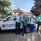 Macmillan volunteer Bradley Allen receiving the cheque for £7,190 from the Oliver & Akers team - own