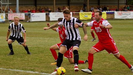 Declan Rogers holds off a defender during St Ives Town's victory against Tamworth. Picture: LOUISE T