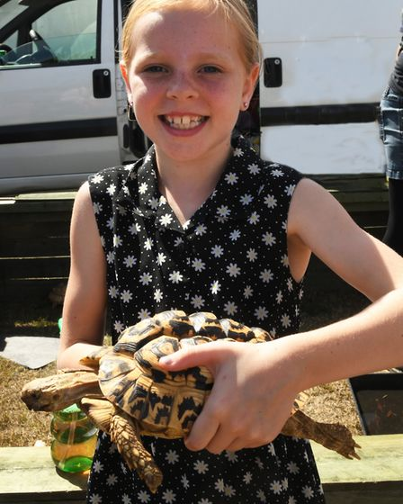 Lauren Gore, aged 9, with her tortoise. Picture: ARCHANT