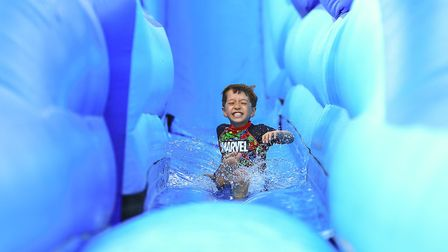 Slash down on the giant waterslide at Meraki Festival 2018. Picture: KEVIN RICHARDS