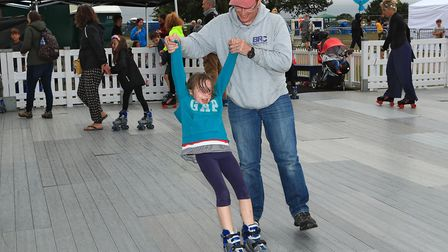 Dad teaches how to roller-skate at Meraki Festival 2018. Picture: KEVIN RICHARDS