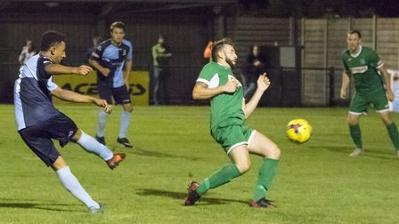 Dion Sembie-Ferris gets in a shot during St Neots Town's victory over Bedworth United. Picture: CLAI