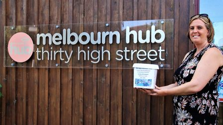 Johanna Barnaby with a collection box at the fundraising cream tea at the Melbourn Hub. Picture: Cli