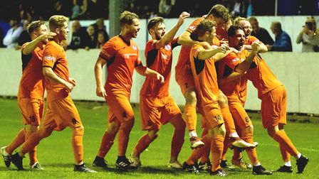 St Ives Town players celebrate their late winner at Lowestoft. Picture: GEMMA THOMPSON