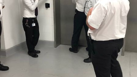 The security guards putting an out of order sign on the lift while Stephen Clarke and his family wer