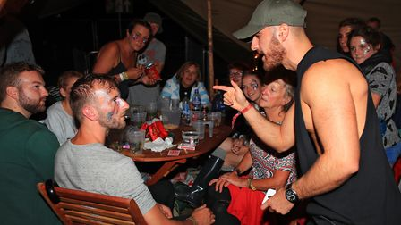 Street Magician Jamie points out he knows what card you have chosen at Meraki Festival 2018. Picture